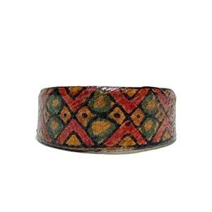 Leather covered metal folk art ring